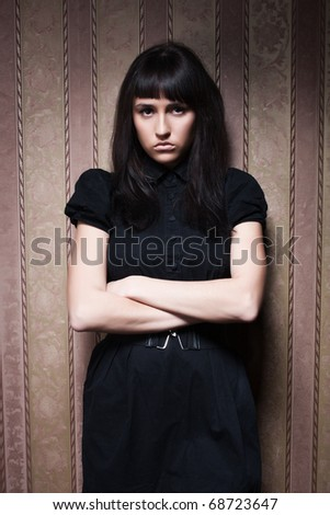 glamorous portrait of a young beautiful girl in the retro interior