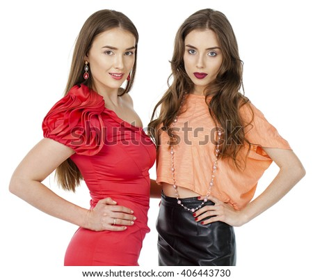 Glamorous portrait of two young beautiful women isolated on white background