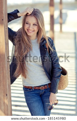 glamorous portrait of young beautiful woman in a leather jacket - stock photo