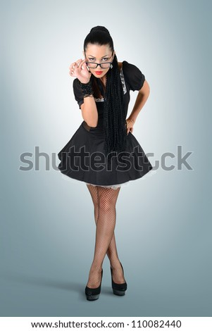 Glamorous sexy maid with glasses, strict woman concept - stock photo