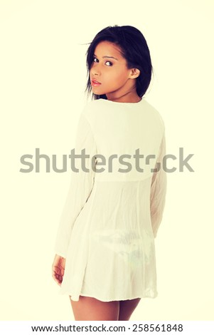 Glamorous tanned young woman in white shirt. - stock photo