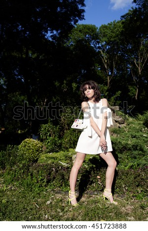 Glamorous woman in white dress. Romantic style portrait of a stunning beauty.  - stock photo