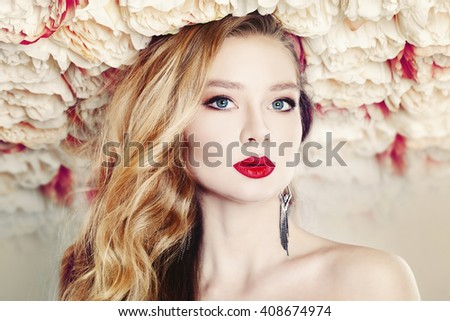 Glamorous Woman on Summer Flowers Background - stock photo