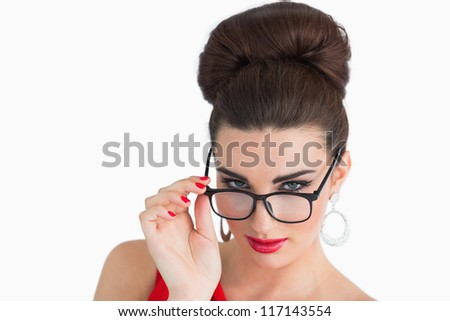 Glamorous woman wearing glasses and looking at camera - stock photo