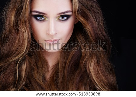 Glamorous Woman with Long Permed Hair and Smokey Eyes Party Makeup