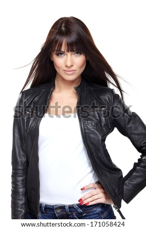 Glamorous young woman in black leather jacket on white background - stock photo