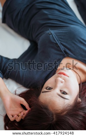 Glamorous young woman on the bed