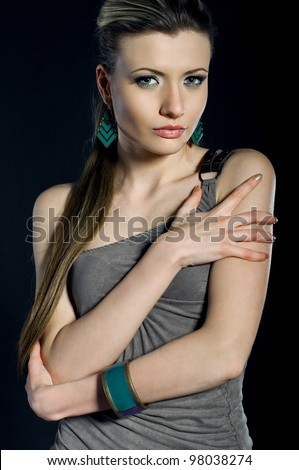 Glamorous young woman on the black background - stock photo
