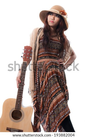 Glamorous young woman with her guitar on a white background - stock photo
