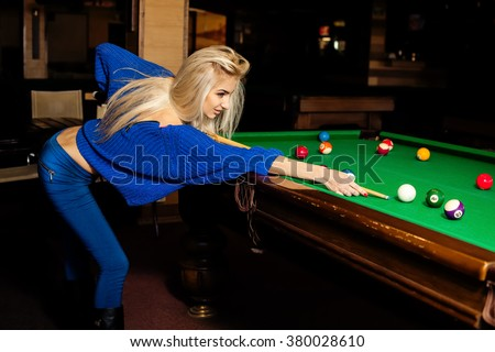 Glamour beautiful blonde woman plays billiard. Billiard sport concept. Pool billiard game. American pool billiard. - stock photo