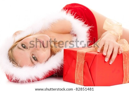 glamour christmas woman lying on floor with gift