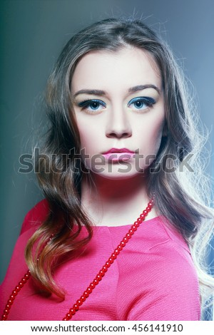 Glamour close-up portrait of beautiful woman model face with winged bright blue eyeliner make-up
