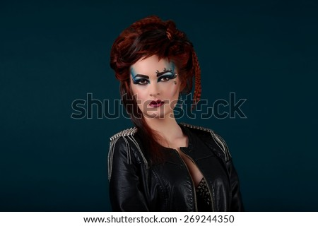 Glamour closeup of attractive young girl on blue background with makeup - stock photo