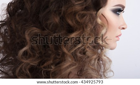 Glamour Curly Hairstyle Beautiful Young Woman. Perfect skin. Sexy Young Girl Face