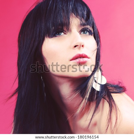 Glamour fashion woman portrait. Studio photography. Portrait of a beautiful brunette.