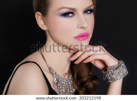 glamour girl with bright make-up and bracelet ,Jewelry on black background - stock photo
