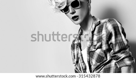 Glamour Girl with fashion Hairstyle and Trendy Sunglasses - stock photo