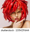 Glamour. Hot Chili Pepper on Shiny Woman's Face. Creative Concept - stock photo