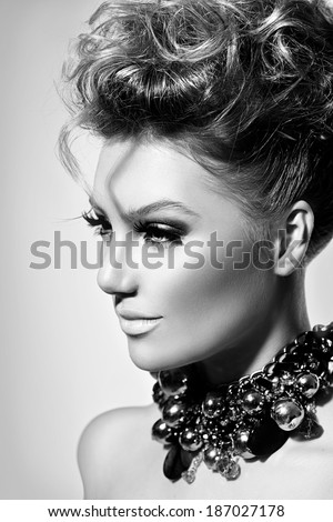 Glamour lady portrait. Beautiful model girl with perfect fashion makeup and hairstyle. Beauty young woman Vogue Style black and white portrait. Trendy accessories. Hairdressing - stock photo