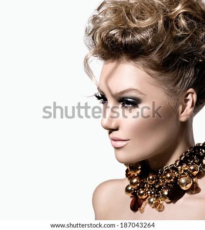 Glamour lady portrait. Beautiful model girl with perfect fashion makeup and hairstyle. Trendy accessories. - stock photo