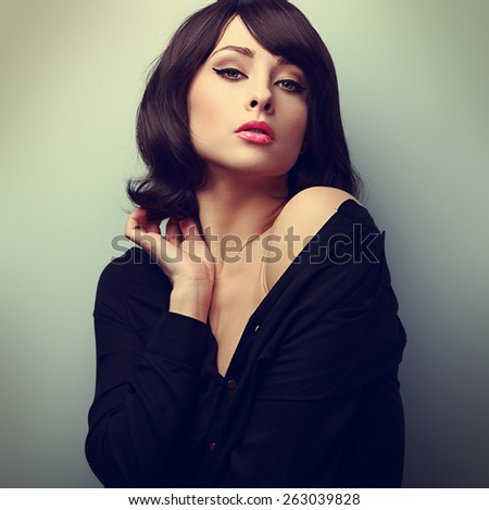 Glamour makeup woman touching short hair with sexy look. Vintage art color portrait - stock photo