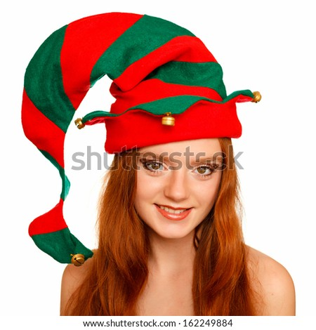 Glamour portrait of a beautiful young red-haired girl with a butterfly-style make up in elf's hat. Only eyes in focus. - stock photo