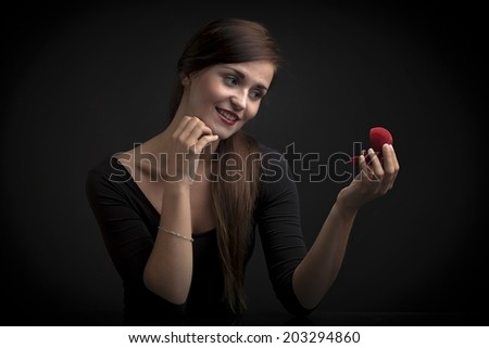 Glamour portrait of a woman with engagement ring - stock photo