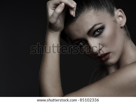 Glamour portrait of a young attractive brunette