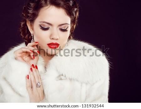 Glamour portrait of beautiful woman model  in luxury fur coat over black - stock photo