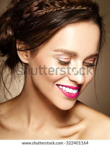 glamour portrait of beautiful  woman model lady with fresh daily makeup with red lips and clean face and romantic wavy hairstyle on brown background - stock photo