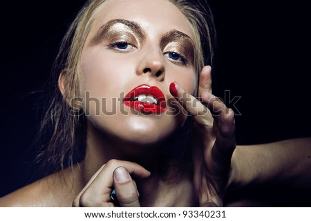 Glamour portrait of beautiful woman model with beautiful make up on dark background - stock photo
