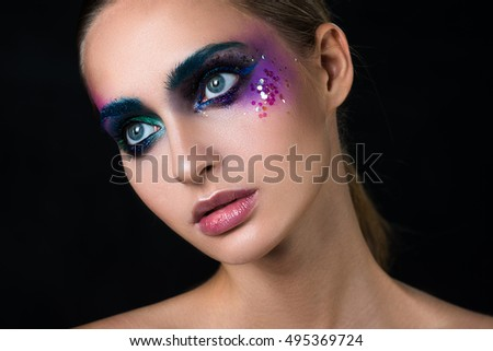 Glamour portrait of beautiful woman model with creative art make-up. Different colours.