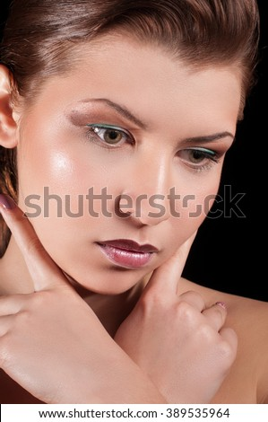 Glamour portrait of beautiful woman model with fashion makeup