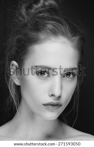 Glamour portrait of beautiful woman model with fresh daily makeup and romantic hairstyle. Fashion shiny highlighter on skin, sexy gloss lips make-up and natural eyebrows