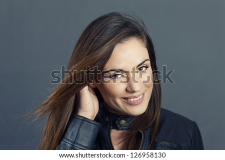 Glamour portrait of beautiful woman model with hand in hair - stock photo