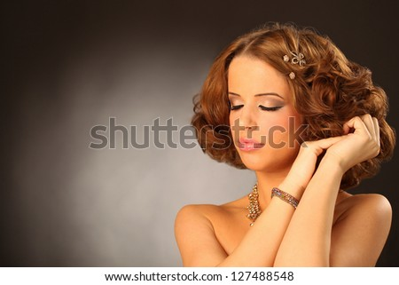 Glamour portrait of beautiful woman model with  makeup and romantic wavy hairstyle. - stock photo