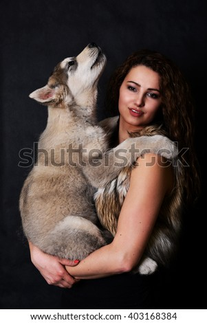 Glamour portrait of beautiful woman  with dog - stock photo