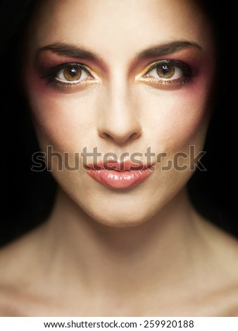 glamour portrait of beautiful young brunette girl wearing make-up, showing kissing gesture. closeup image - stock photo