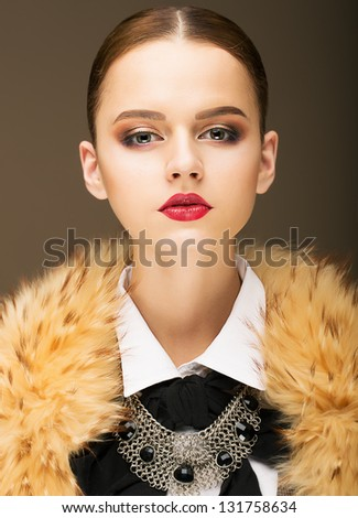 Glamour. Portrait of Honorable Fashionable Woman in Rufous Fur Collar - stock photo