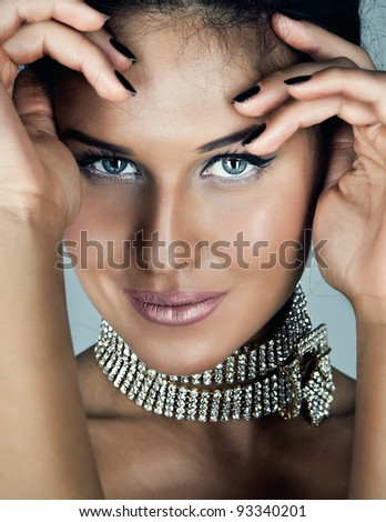 Glamour portrait of sexy beautiful young woman with deep blue eyes - stock photo