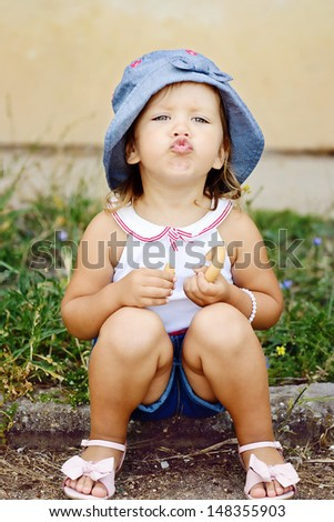 glamour toddler with funny duck face