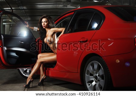 Glamour woman in a red car - stock photo