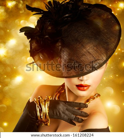 Glamour Woman Portrait over Holiday Gold Background.Luxury Golden Jewelry. Gorgeous Vogue Style Lady wearing Hat and Gloves. Jewellery. Vintage Styled Retro Girl - stock photo