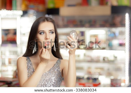 Glamour Woman with Lipstick and Make-up mirror - Cool girl holding a mirror and getting ready for a party  - stock photo