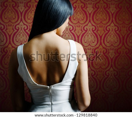 Glamour woman with shiny brunette hair and sexy shoulders - stock photo