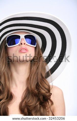 glamourous girl in striped hat and sunglasses - stock photo