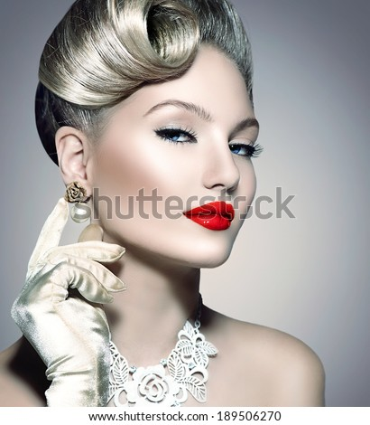 Glamourous Retro Woman Portrait. Beauty Glamour Lady. Jewellery. Pearl Earrings. Vintage styled Girl with perfect make up and hairstyle. Luxury Accessories. Golden Jewelry - stock photo