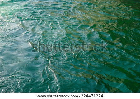glare and reflective surface water in river - stock photo