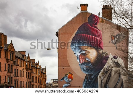 GLASGOW APRIL 02, 2016; Mural painting of a man with birds, on wall in central Galsgow, Scotland.  - stock photo