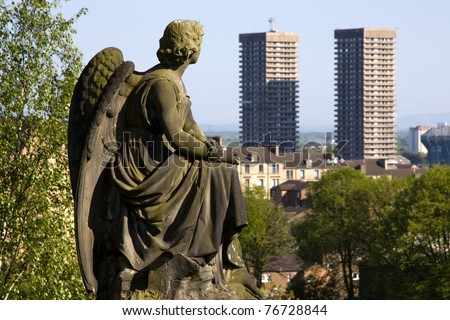 Glasgow Necropolis burial ground statue of Victorian angel contemplating two modern high rise tower blocks against the skyline denoting the city's many contrasts between old and new, rich and poor etc - stock photo